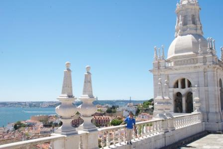 Rodrigo on the rooftop of the Royal Monastery of São Vicente de Fora overlooking the city of Lisbon