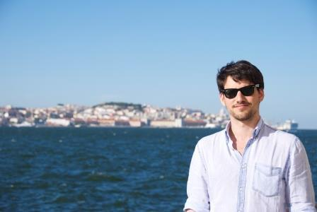 Rodrigo, walking near Almada, on the opposite bank of the river Tejo, with Lisbon behind him